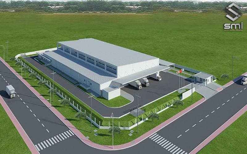 Nhà xưởng hình chữ L có một khu vực trống để dự kiến mở rộng cho tương lai, tạm thời dùng làm nơi ra vào cho đội ngũ xe tải
